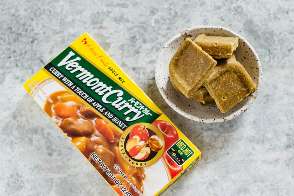 store bought Japanese curry roux packet on the left and homemade Japanese curry roux on the right in a bowl