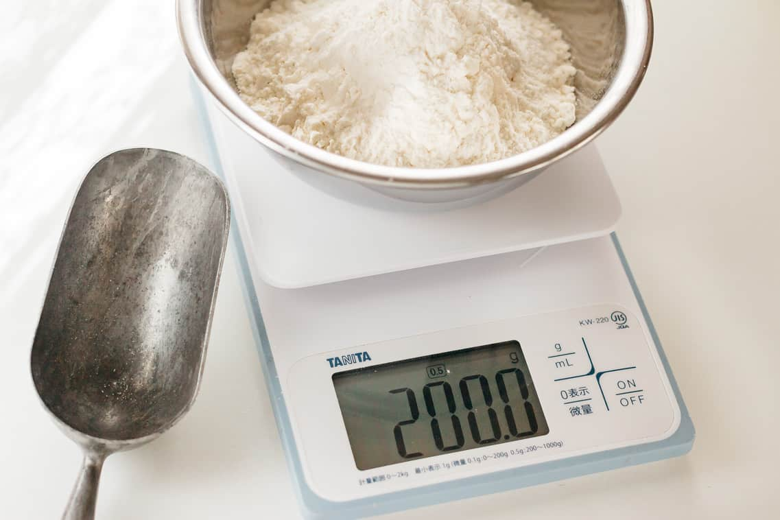 A kitchen scale measuring flour