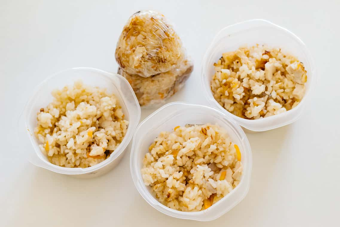 seasoned rice in three small container and made into a rice ball.