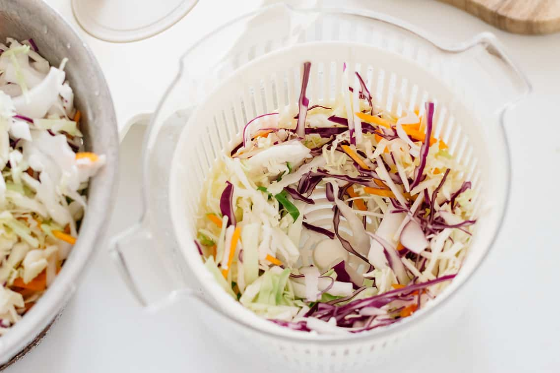 asian slaw ingredients in a salad spin