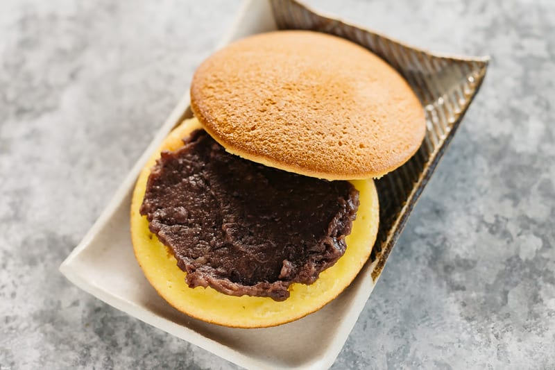 dorayaki with sweet azuki bean paste opened on a rectangle plate