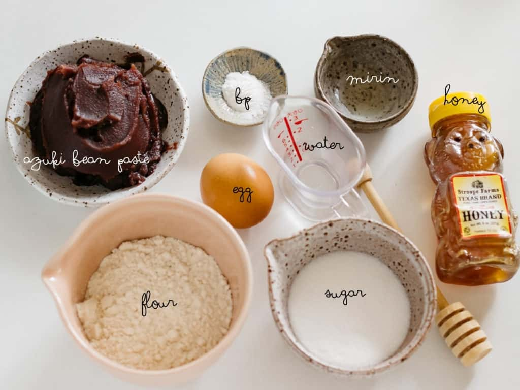 azuki bean paste, flour, sugar, baking powder, egg, water honey and mirin in small bowls
