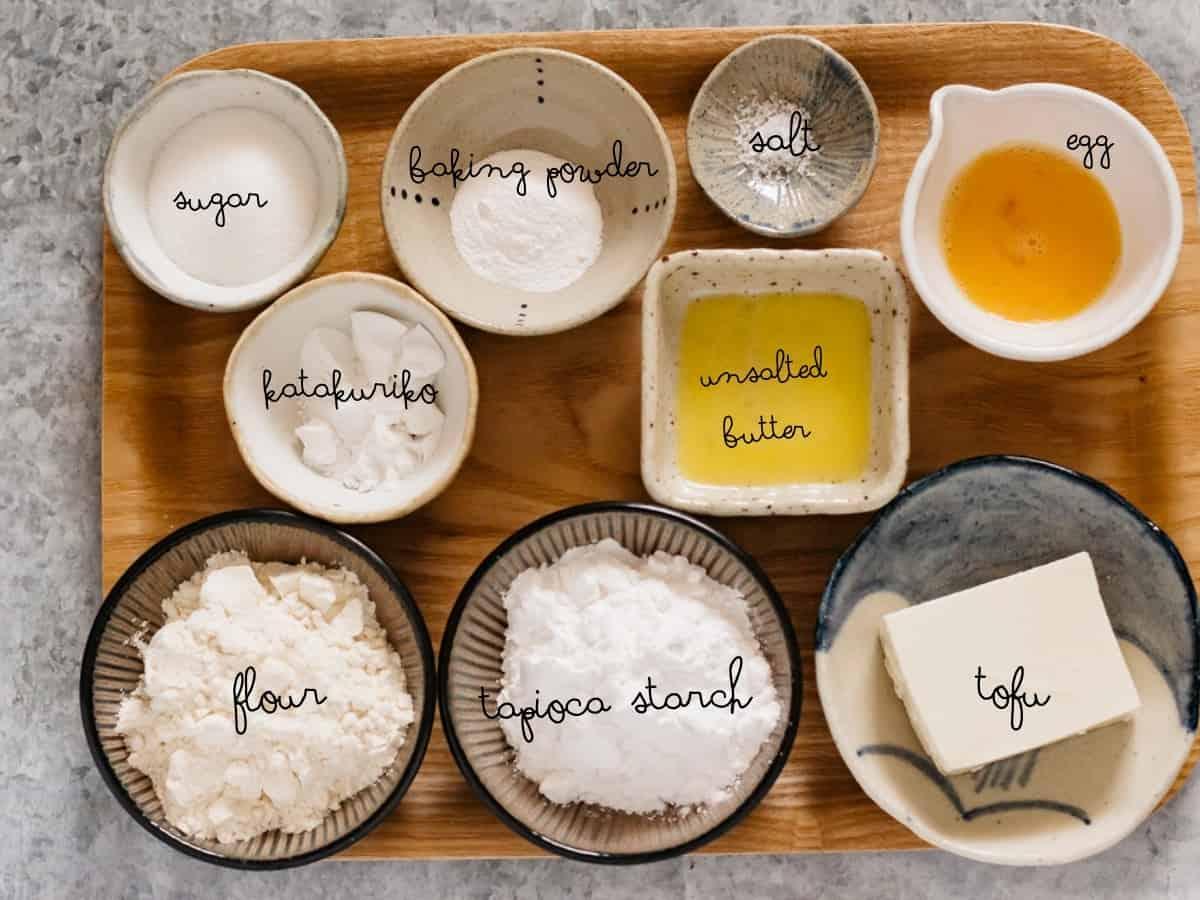 All purpose flour, tapioca starch, katakuriko, sugar, baking powder, salt, beaten egg, melted butter and tofu in small bowls