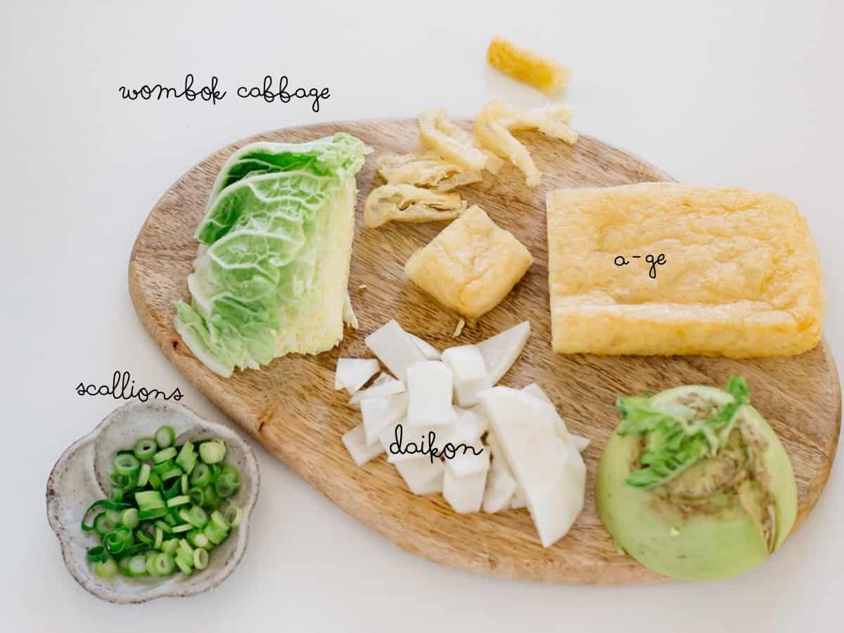 finely chopped scallions, napa cabbage, age deep fried tofu