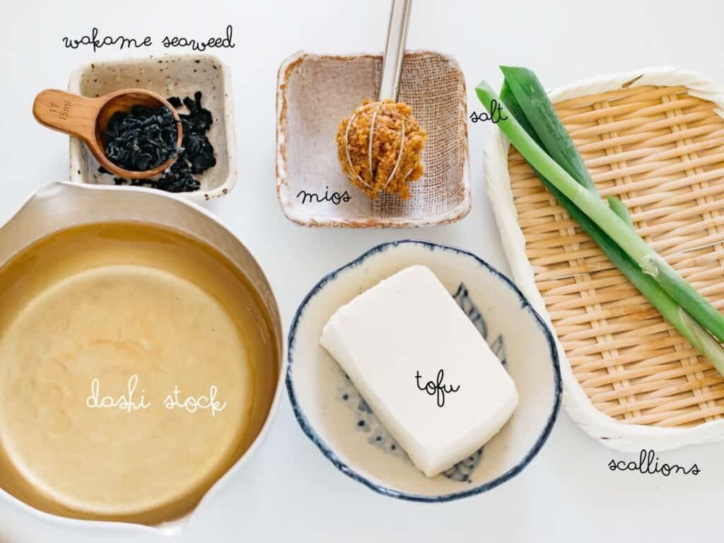dashi stock, tofu, dried wakame seaweed, scallions and miso in bowls