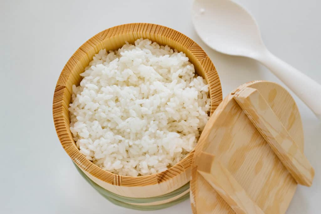 Japanese Koshihikari rice in a wooden tub with a lid