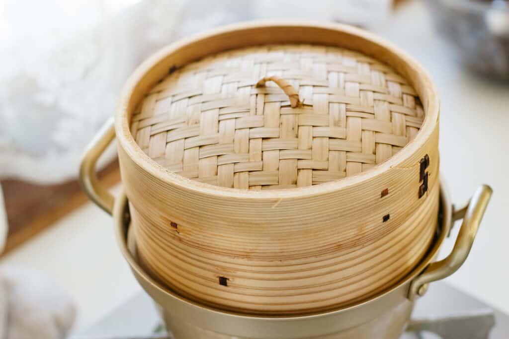 A bamboo steamer on a pot