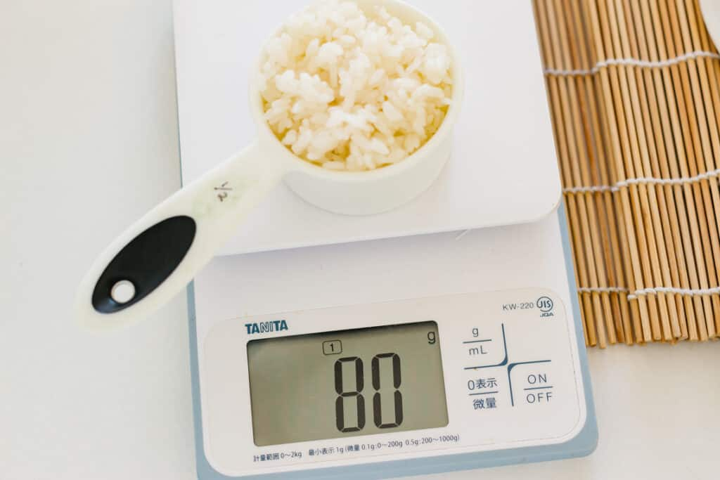 1/2 cup of sushi rice on a kitchen scale