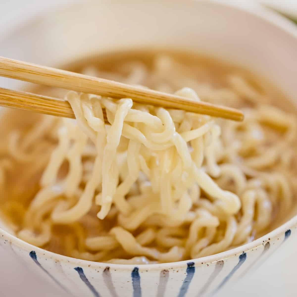 homemade ramen noodles cooked and served with ramen broth