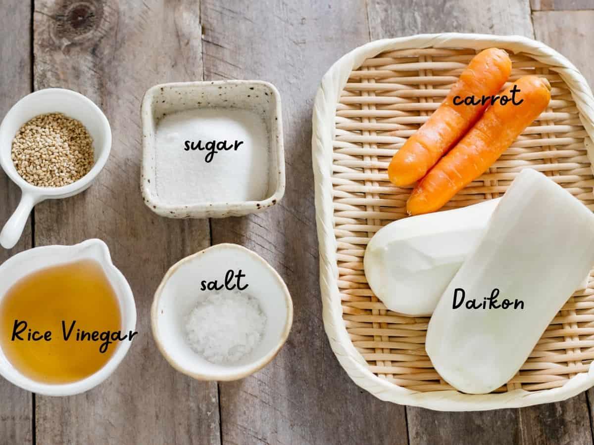 rice vinegar, sugar, salt, carrot and Daikon and sesame seeds