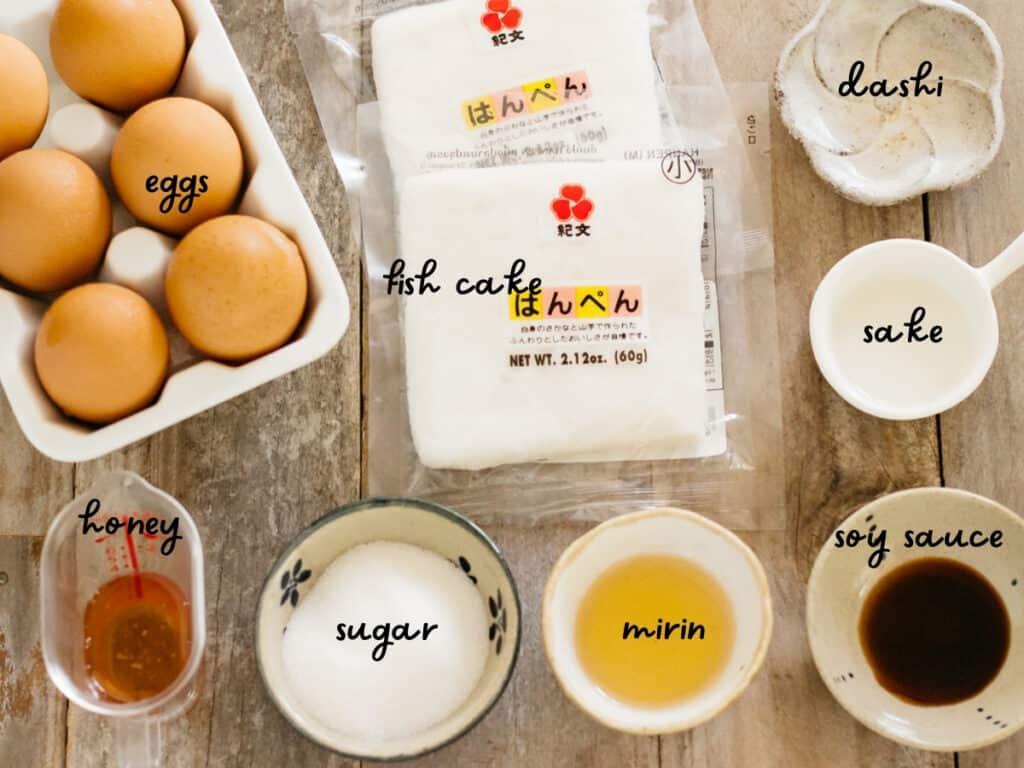 6 eggs, 2 hanpen fish cakes, dashi, sake, honey, mirin, fugar and soy sauce in small bowls.