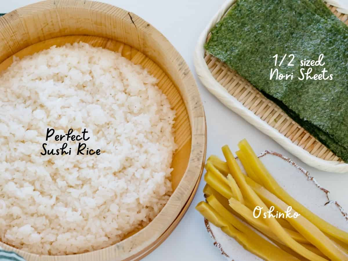 Oshinko roll ingredients - sushi rice in hangiri, cut oshinko, and nori seaweed sheets