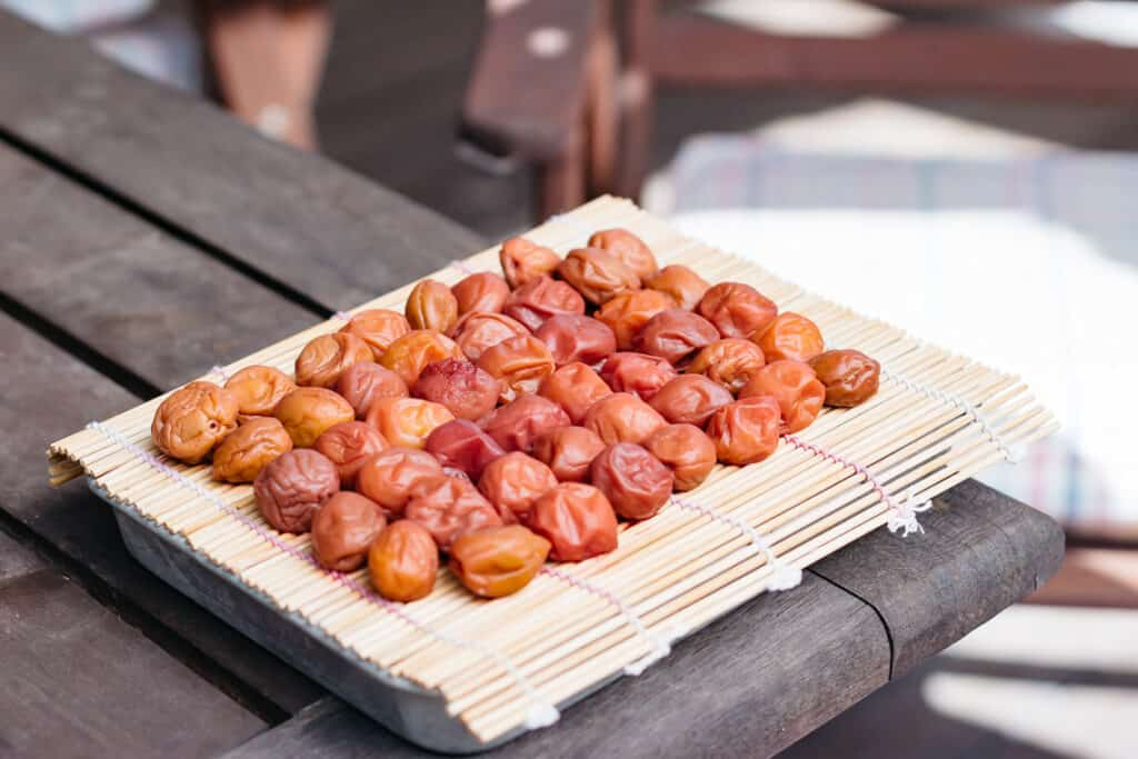 pickled plum are being sun dried