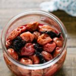 Pickled umeboshi plums in a glass preserve jar
