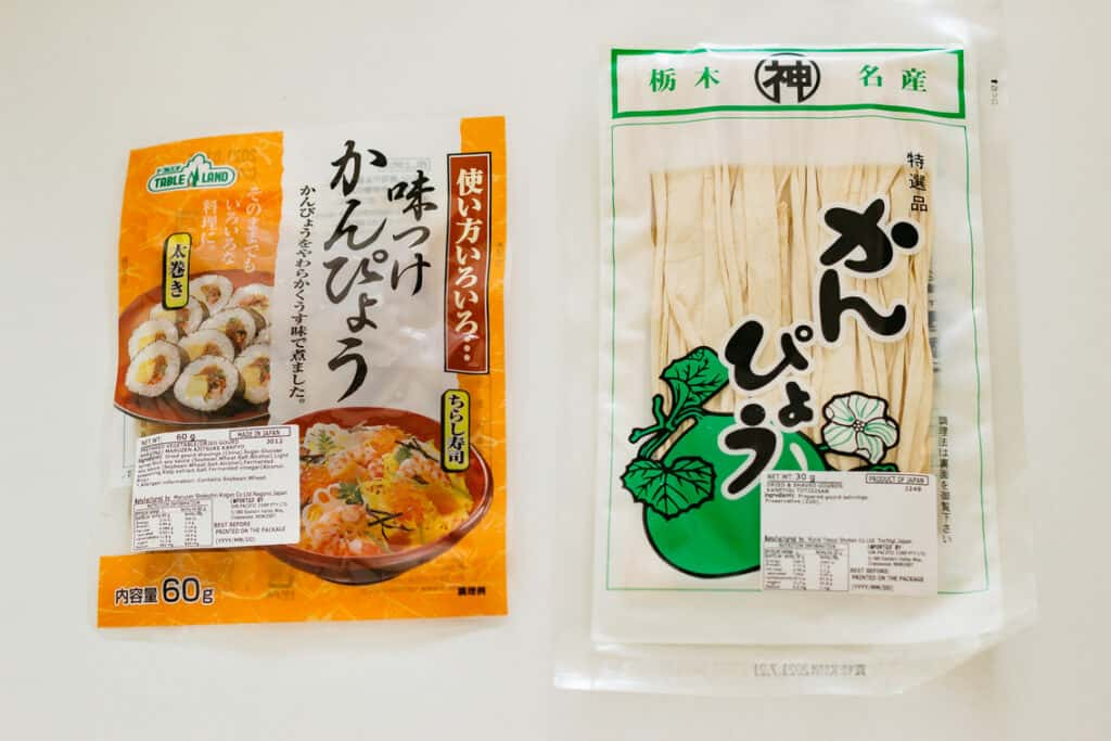ready to use cooked kanpyo in a packet on the left and dry kanpyo in a packet on the right