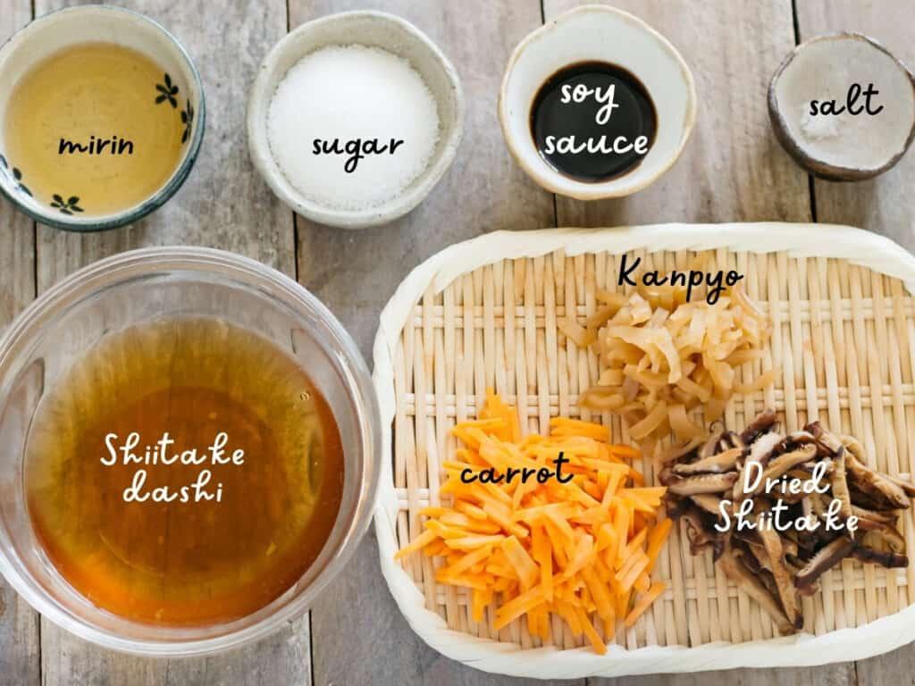 shiitake dashi, mirin, sugar, soy sauce and salt in small bowls and carrot, kanpyo, and shiitake on a bamboo tray