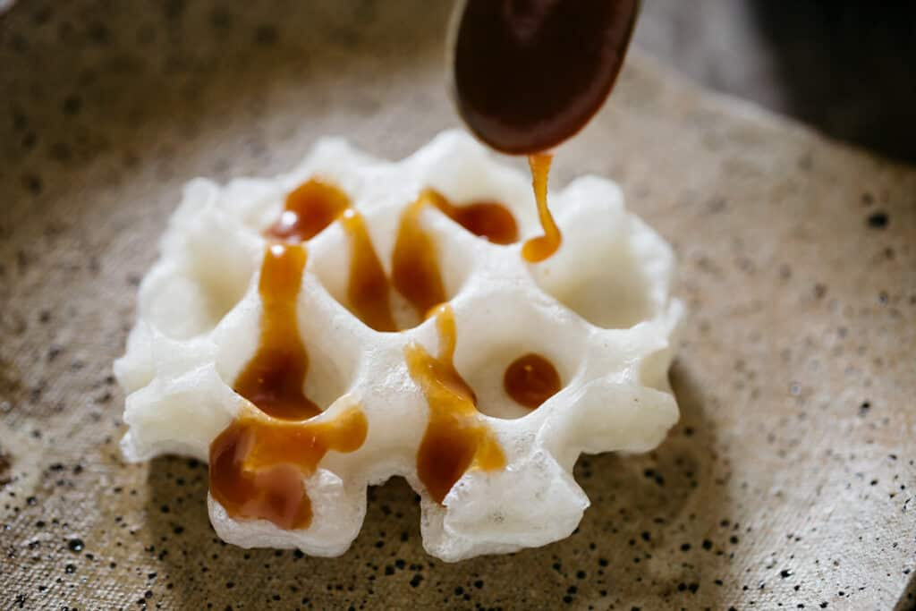 Miso caramel drizzled over moffle