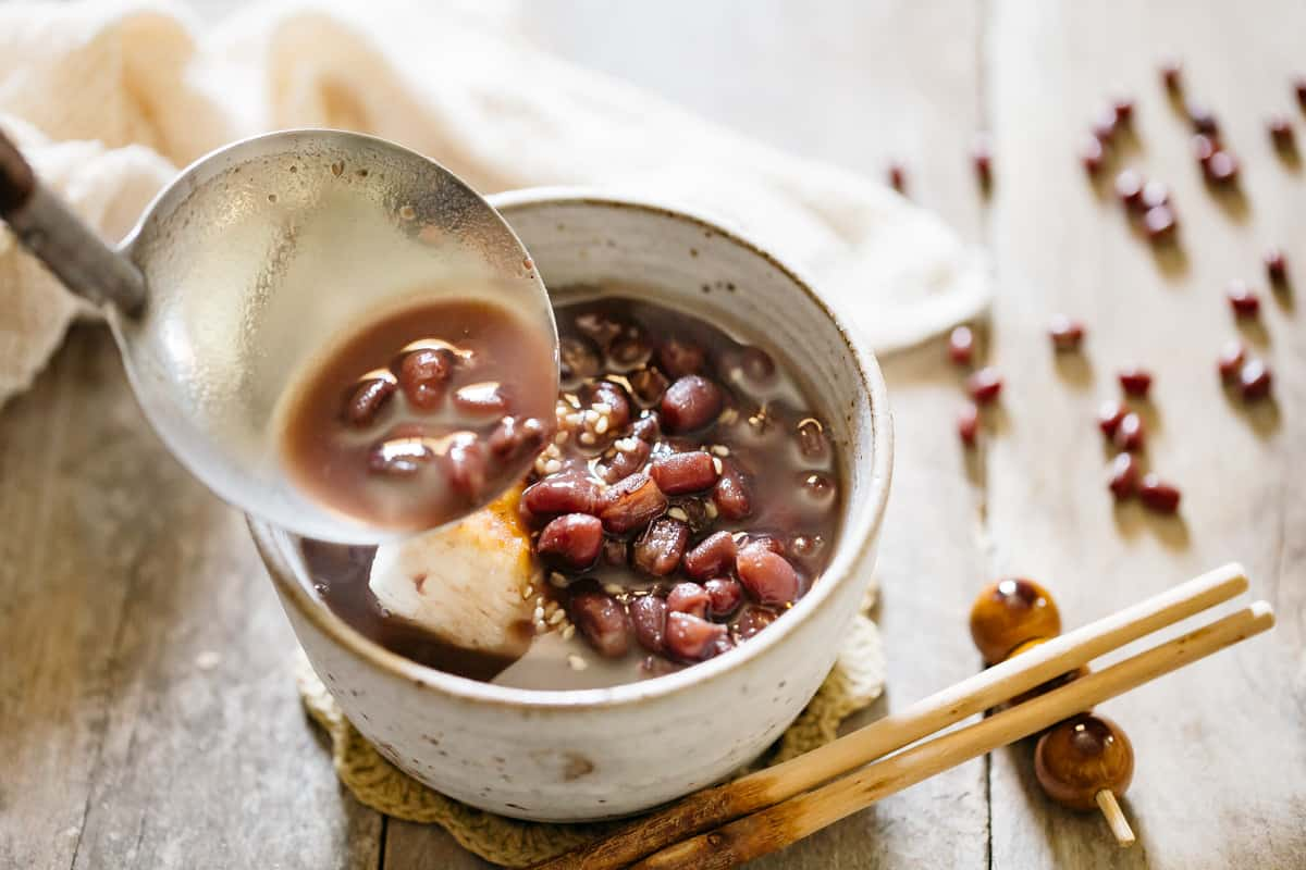 Oshiruko red bean soup being served by a ladle
