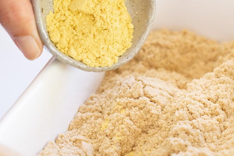 adding Japanese mustard powder to  rice bran pickling bed