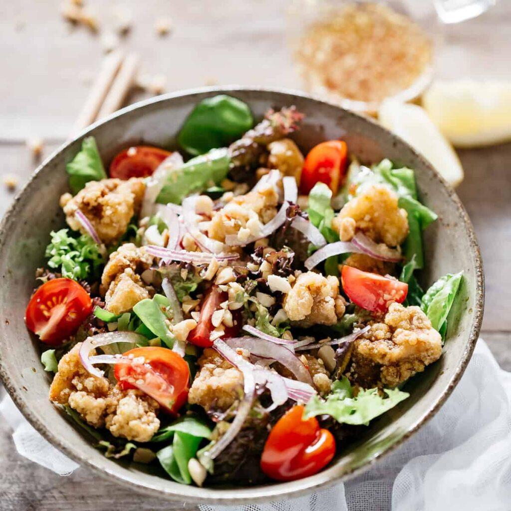 kara age chicken salad served in a round ball