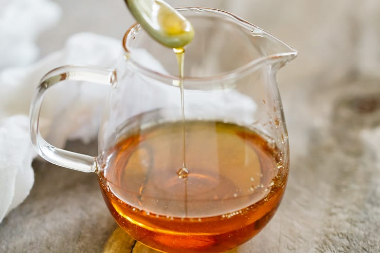 Caramel sauce in a small glass jug