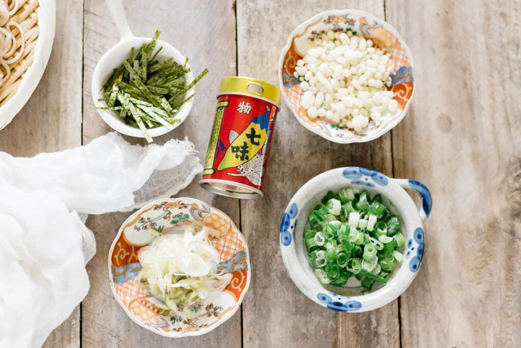 shredded seaweed, tenkasu, chopped scallions and myoga in a small bowl
