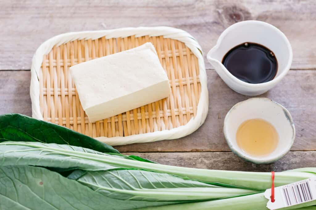 firm tofu, soy sauce, mirin and a bunch bok choy
