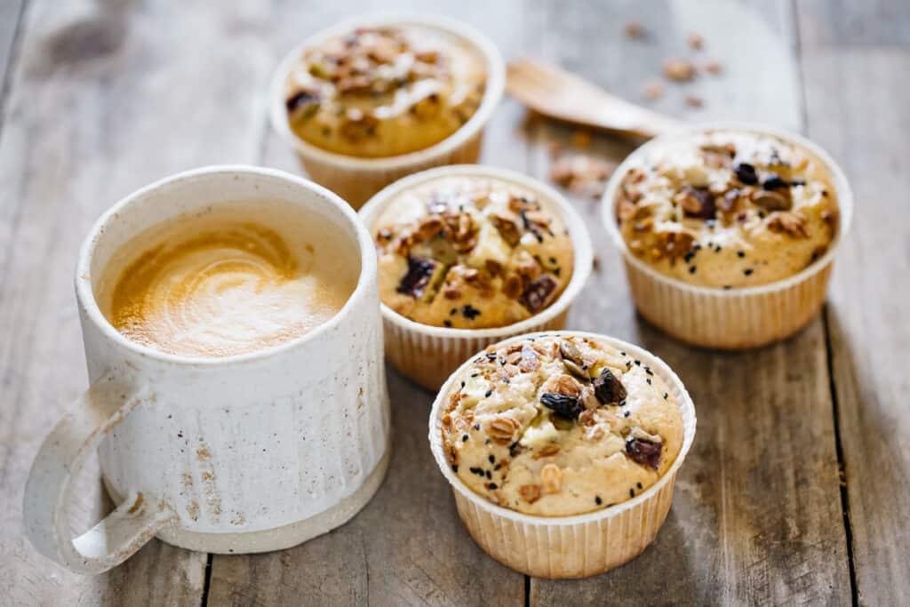 4 sweet potato granola cakes on the table with a coffee mug