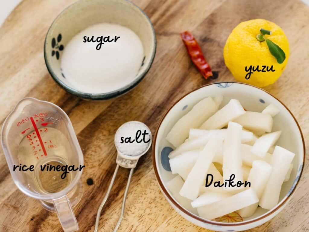 cut daikon, a yuzu fruit, sugar, salt, rice vinegar and birdseye chilli